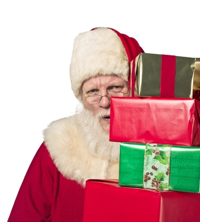Santa Claus holding a lot of gifts over the white background photo
