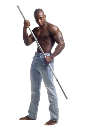 Portrait of a muscular African American man posing with a rod against white background, Model: Gregory Dawson