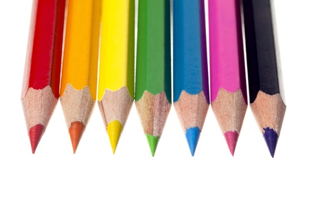 Close-up shot of sharp color crayons arranged on white background. Stock Photo - 17244994