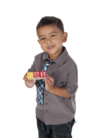 Portrait of a smiling Asian boy holding building blocks, photo
