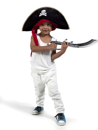 Smiling little pirate holding his sword over white background, photo