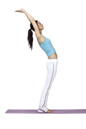 Young fitness woman bending and raising her hands in a side view image photo