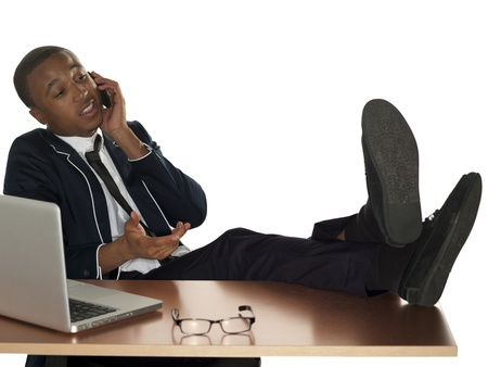 Young prfessional kicks his feet up at the office. Stock Photo - 17244314