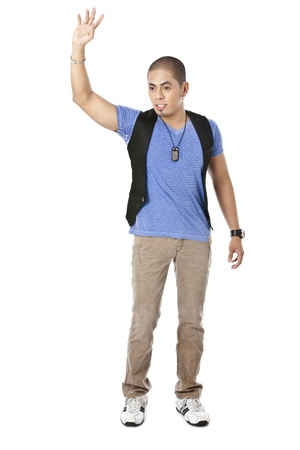 pinoy: Portrait of guy standing while raising his hand against white background
