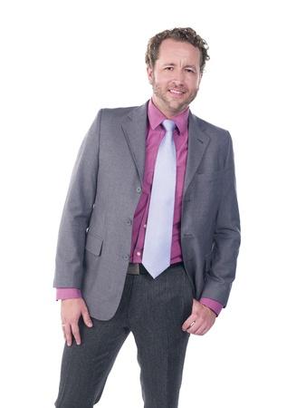 Handsome young doctor smiling over white background, Model: Derek Gerhardt photo