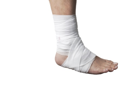 Close-up of a human leg wrapped with white bandage. photo