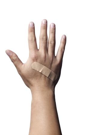 band aid: Close-up shot if a bandage on human hand.