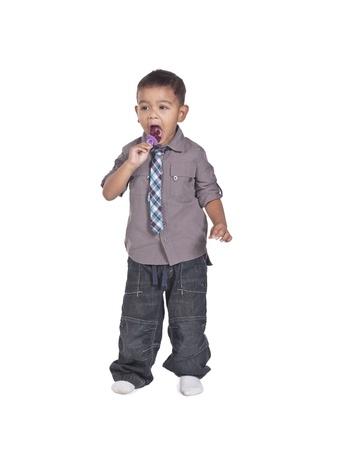 View of a cute boy sucking a pacifier. Model: Kai Wall photo