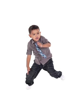 Close-up image of a cute boy dancing on a white background photo