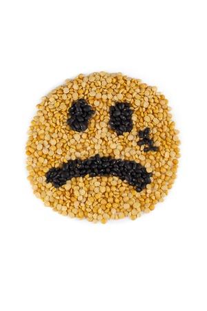 Image of sad face made of beans on white background Stock Photo - 17251247