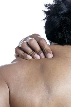 douleur epaule: Gros plan image de douleur � l'�paule contre un fond blanc Banque d'images