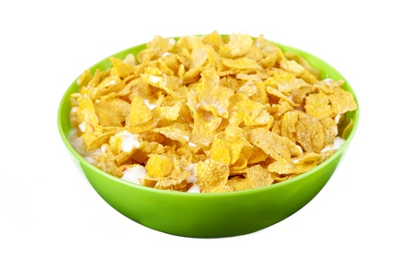 Corn flakes with milk on a green bowl Imagens
