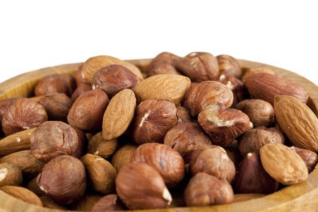 Close up image of almond and walnut on wooden bowl against white background Stock Photo - 17251588