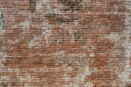 Oude bakstenen muur een achtergrond afbeelding in Stockfoto