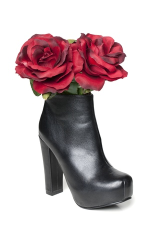 Black High heeled Leather shoe with two red rose on a macro image isolated on Stock Photo - 17251304
