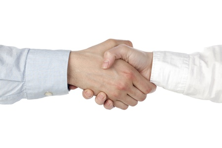 Close-up image of two businessmen shaking their hands over the white background