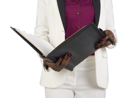 Cropped image of a businesswoman holding a folder and pen Stock Photo - 17251151