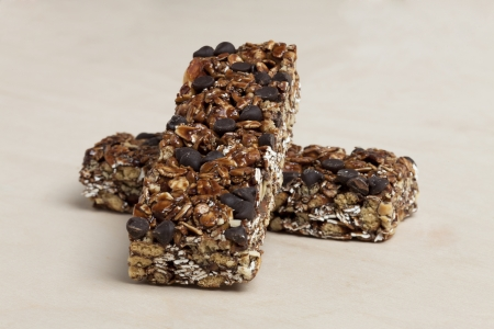 chewy: Two chewy chocolate granola bars over a beige background