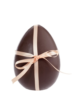 closed ribbon: Closed up image of a chocolate egg tied with a glossy ribbon separated in a white background Stock Photo
