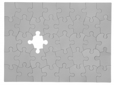 Detailed shot of missing piece on jigsaw puzzle. Stock Photo - 17251568