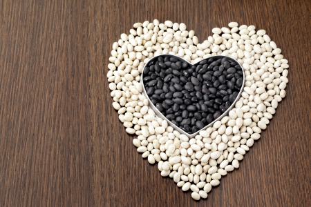 Close-up shot of heart shape beans on wooden table. Stock Photo - 17253028