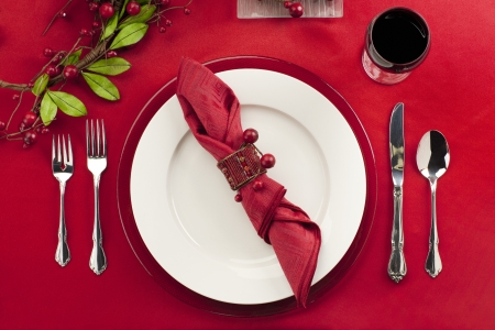 Close-up shot of restaurant table with fork, plate, knife, berries and napkin photo