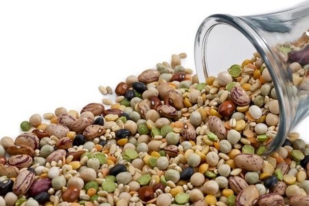 Assorted beans spilled on a glass jar over the white background Stock Photo - 17251367