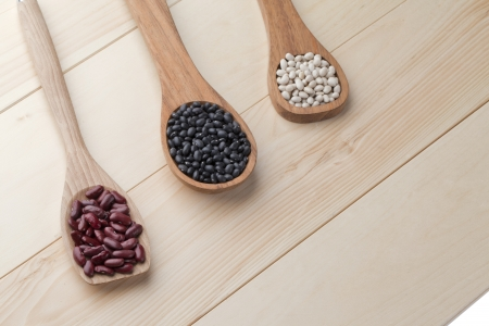 Overhead shot of the wooden spatula with assorted beans