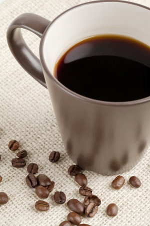 caffeine molecule: Close up image of black coffee with coffee beans