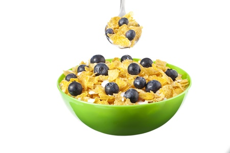 Horizontal image of a bowl and spoon of cereals mixed with milk and blueberries Stock Photo - 17251147
