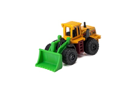 sand quarry: Close up image of bulldozer toy truck against white background Stock Photo