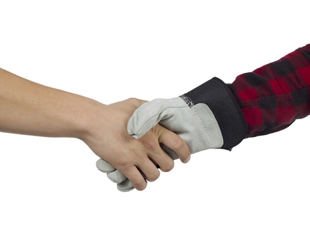 Close-up image of a man's handshake over the white surface Stock Photo - 17251177
