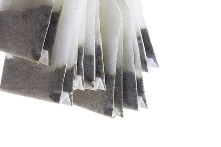 Detailed shot of tea bags on white background. photo