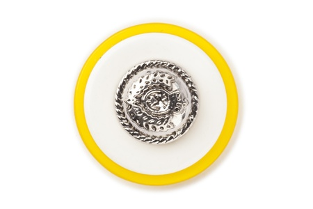 Close up image of cloth button with silver design and yellow lining against white background Imagens