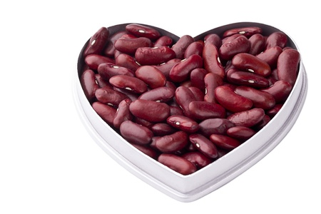 Close-up shot of red kedney beans in a heart shape container. photo