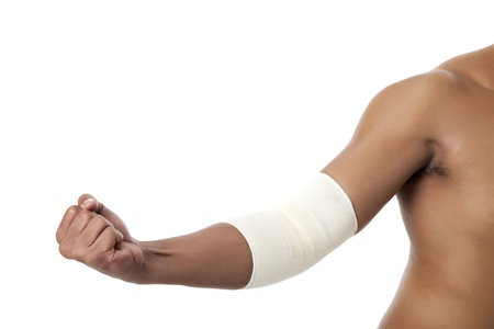 Cropped image of a medicine bandage on human elbow, Model: Rodolfo Batalla Jr. photo