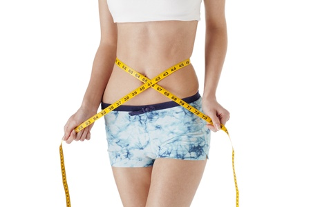 Midsection of slim woman measuring her waist on white background Stock Photo - 17251990