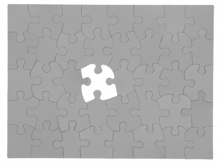 Close-up shot of missing piece of grey jigsaw puzzle. Stock Photo - 17252188