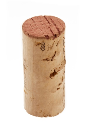 A portrait of an old wine cork on a white background