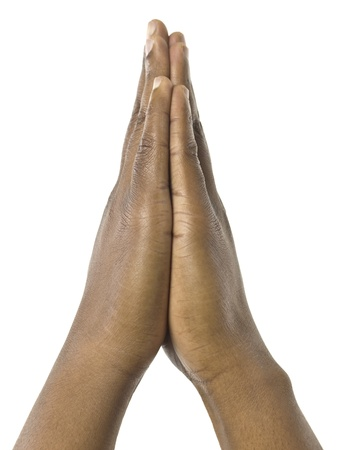 Close-up image of a praying hand against the white surface Stock Photo - 17251993