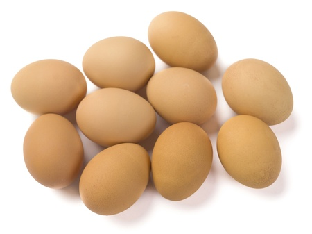 displayed: Close-up shot of brown eggs displayed on white background.