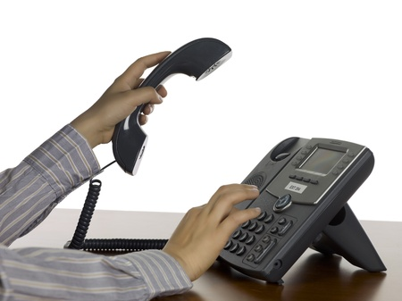 Close up image of dialing on telephone against white background
