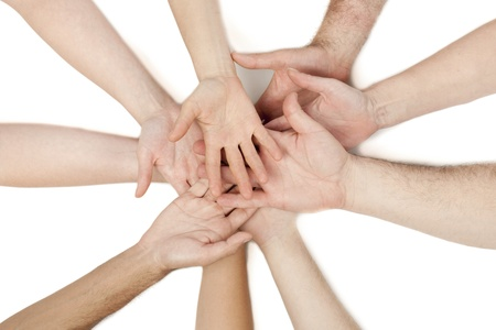 Diverse group of hands put on top of each other isolated in a white background Stock Photo - 17252393