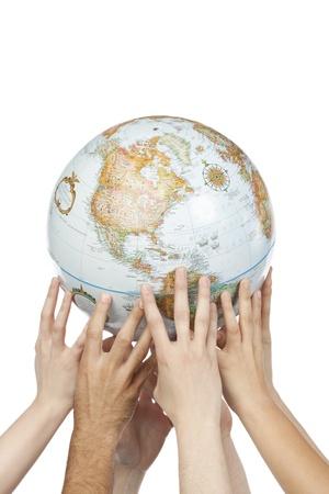 Image of diverse hands holding globe isolated on white background Stock Photo - 17252425