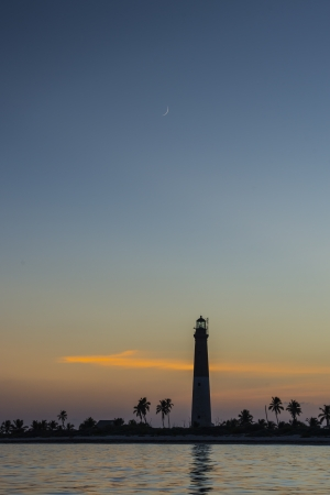 nightfall: Distant shot of Dry Tortugas Lighthouse during nightfall Stock Photo