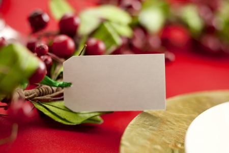 table surface: Close-up shot of a blank label with red berries