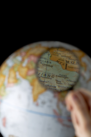 Selective focus image of a magnifying glass exploring a terrestrial globe Stock Photo - 17252422