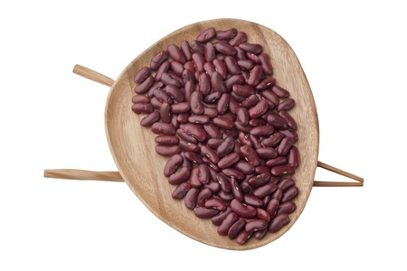 Red beans in a wooden plate with chopstick over a top view image Stock Photo - 17252376