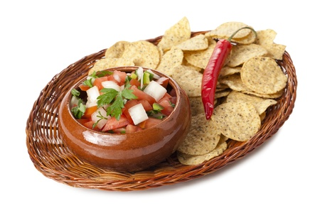 Image of fresh salsa dip with nachos wicker plate against against white background photo