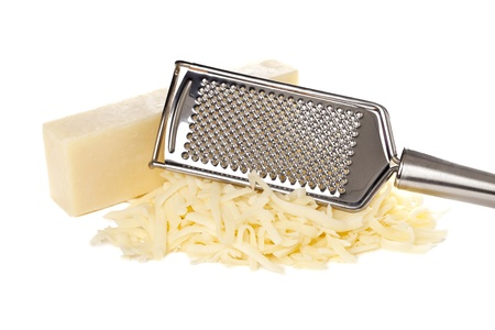Grated bar of mozzarella cheese and metal cheese grater Foto de archivo
